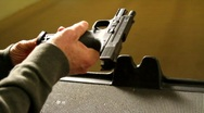 Stock Video Footage of Loading Semi Automatic Pistol
