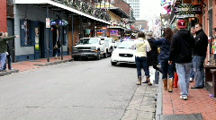 Police Car followed by carriages on bourbon st Stock Footage