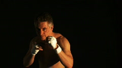 man boxing over black background - stock footage