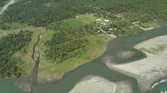 Aerial over rural river delta with a lagoon separated from the ocean Stock Footage