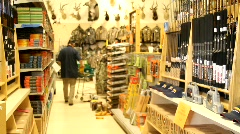 Stock Video Footage of Man Shopping at Hunting Store