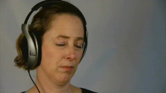 Woman with headphones Stock Footage