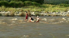 group riding raft on river - stock footage