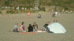 Group with people sitting on the beach Stock Footage