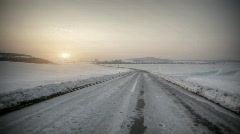 Driving in snow country with sunset in horizon Stock Footage