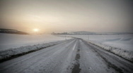 Stock Video Footage of Driving in snow country with sunset in horizon