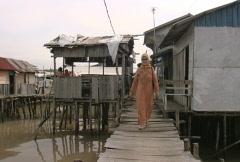 Batam harbour poor fisherman's houses  Stock Footage
