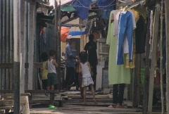 Batam harbour children in a narrow street Stock Footage