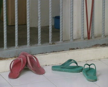 Batam Indonesia prison two pair of sandals at a cell  Stock Footage