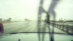 Driving in the rain - 2 - 18 wheeler passing on freeway - stock footage