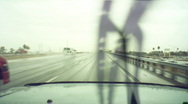 Stock Video Footage of Driving in the rain - 2 - 18 wheeler passing on freeway