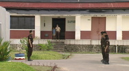 Stock Video Footage of Batam Indonesia prison guards two shot