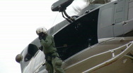 Helicopter Crew Chief Observes from Hover (HD) Stock Footage