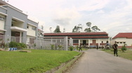 Stock Video Footage of Batam Indonesia main prison square with sound of sirens