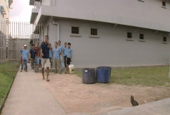 Batam Indonesia detainees standing at a gate  Stock Footage