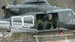 Gunner Seen in Open Doorway of Military Helicopter at Take Off Stock Footage