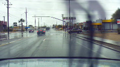 Driving in the rain - 3 - flooded intersection approach Stock Footage