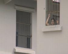 Batam Indonesia detainee behind window with bars  - stock footage