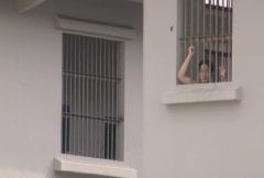 Batam Indonesia detainee behind window with bars  Stock Footage