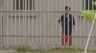 Stock Video Footage of Batam Indonesia detainee behind prison bars