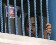 Batam Indonesia a detainee behind bars close up  Stock Footage