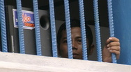 Stock Video Footage of Batam Indonesia a detainee behind bars close up