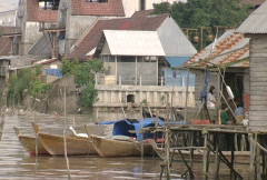 Batam harbour village with boats and houses on poles  Stock Footage