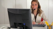 Female receptionist working on computer Stock Footage