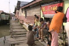 Batam harbour children on a boardwalk  Stock Footage