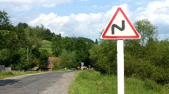 Road sign - hairpin bend Stock Footage