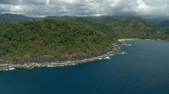 Aerial along a cliff covered in rain forest with dark clouds in the background Stock Footage
