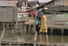 Batam harbour a child walking on the boardwalk  Stock Footage