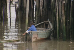 Batam harbour a child in a small boat  Stock Footage