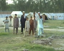 Refugee Children Playing Cricket in UNHCR camp, Pakistan Stock Footage