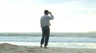 Stock Video Footage of Businessman looking through binoculars