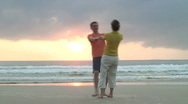 Happy dancing couple on a beach Stock Footage