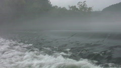vid084 water flowing over weir - stock footage