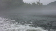 Vid084 water flowing over weir Stock Footage