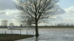 Ship on a swollen river with tree Stock Footage