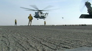 Stock Video Footage of CH-53 Lands on Deck of Aircraft Carrier (HD)