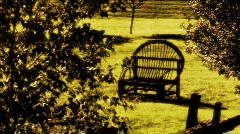 Rattan chair in the sun Stock Footage