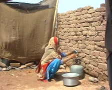 Refugee Family - Girl Cooking 1 Stock Footage