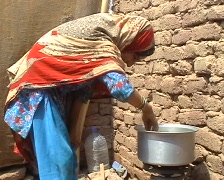 Refugee Family - Girl Cooking 2 Stock Footage