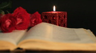 Stock Video Footage of book, candle and red roses.