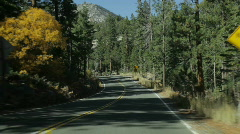 Driving on Emerald Bay Road on an autumn day Stock Footage
