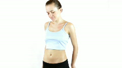 Unhappy young woman measuring her belly - stock footage
