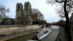 Notre Dame de Paris and pleasure boat on channel Stock Footage