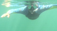 Snorkler Swims towards camera Stock Footage