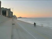Biking at the lakefront PAL by in Stock Footage