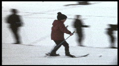 Boy skiing (vintage 8 mm amateur film) - stock footage